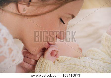 Happy Mother Kiss Hand Her Newborn Baby