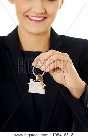 Realtor is giving the keys to an apartment to some clients.