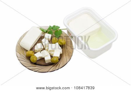 Container Of Feta And Sliced Cheese And Olives On Saucer