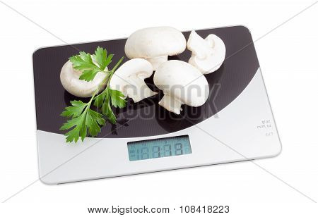 Several Champignon Mushroom On Digital Kitchen Scale