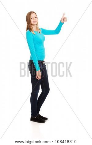 Happy young teenager showing thumbs up