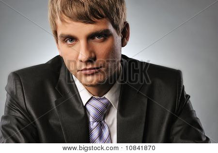 Close-up portrait of a young handsome businessman