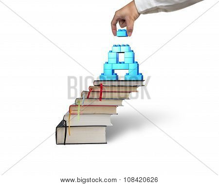 Hand Holding Block Completing Letter A Blocks On Books Stairs