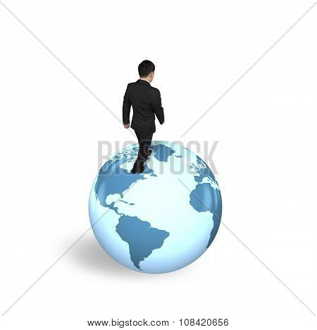 Businessman Walking On Globe With World Map