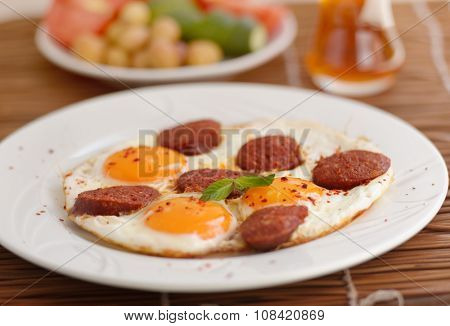Fried eggs with sucuk on a plate