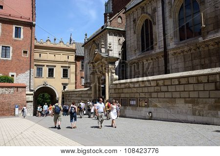 tourists visiting Gothic Wawel Royal Castle in Krakow Poland on June 16 2013