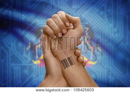 Barcode Id Number On Wrist Of Dark Skinned Person And Usa States Flags On Background - Pennsylvania
