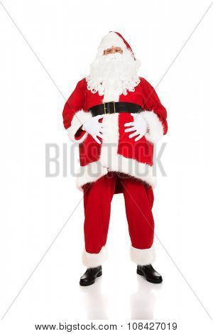 Santa Claus touching his fat belly