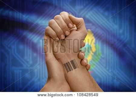 Barcode Id Number On Wrist Of Dark Skinned Person And Usa States Flags On Background - Vermont