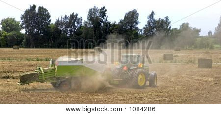 Dust Blowing From A Tractor & Baler