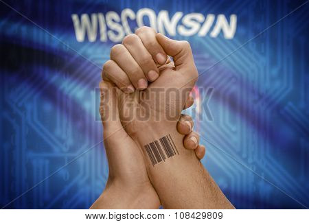 Barcode Id Number On Wrist Of Dark Skinned Person And Usa States Flags On Background - Wisconsin