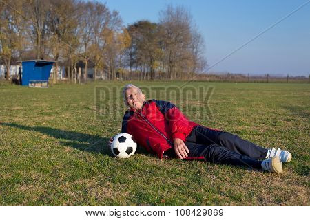 Senior Football Player On Grass