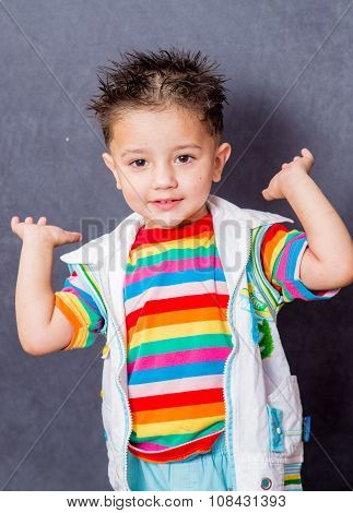 happy mood with clapping hands. boy fashion portrait. Child model.