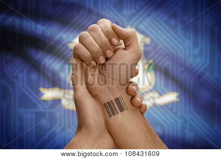 Barcode Id Number On Wrist Of Dark Skinned Person And Usa States Flags On Background - Connecticut