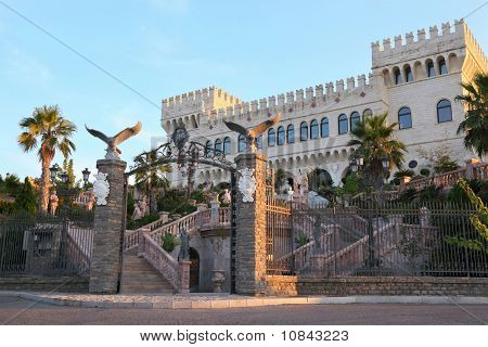 Palace With Two Towers And Parade Stair Which Is Decorated Ancient Statues, Vases And Colors