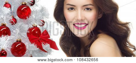 portrait of attractive  caucasian smiling woman brunette isolated on white studio shot christmas new year tree