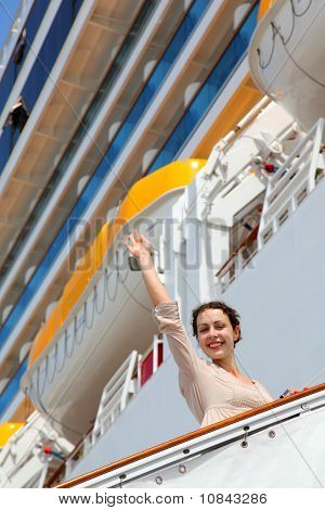 Smiling Girl On Ladder Goes To Cruise Ship And Wave By Straight Hand