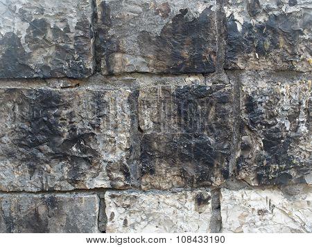 Texture of old grey bricks
