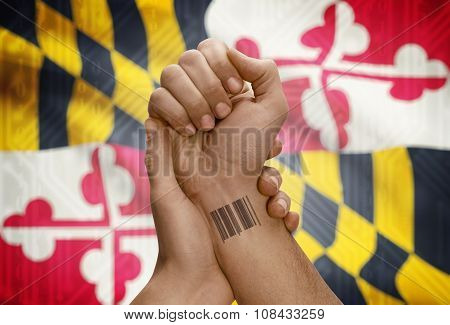 Barcode Id Number On Wrist Of Dark Skinned Person And Usa States Flags On Background - Maryland