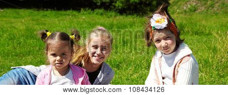 Family Lying On The Grass
