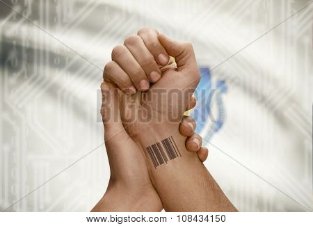 Barcode Id Number On Wrist Of Dark Skinned Person And Usa States Flags On Background - Massachusetts