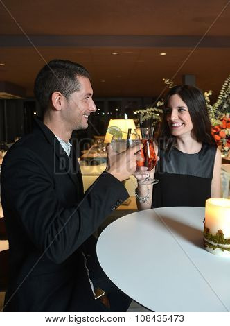 Couple In Love Drinking Cocktails