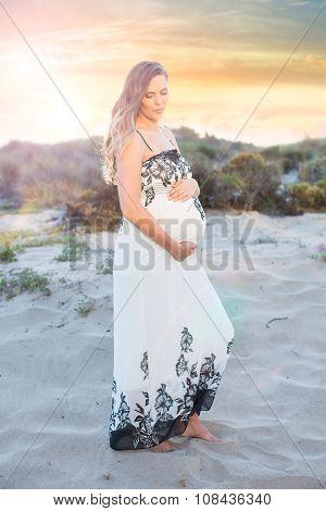 Pregnant woman beach