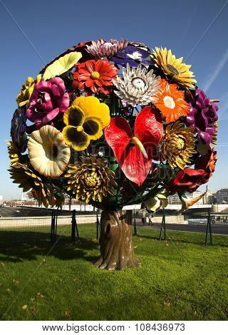 LYON-FRANCE NOVEMBER 15, 2015: Flower tree is a contemporary art with his 85 different flowers made by a korean artist Jeong Hwa Choi and exposed at Antonin Poncet square since 2003.