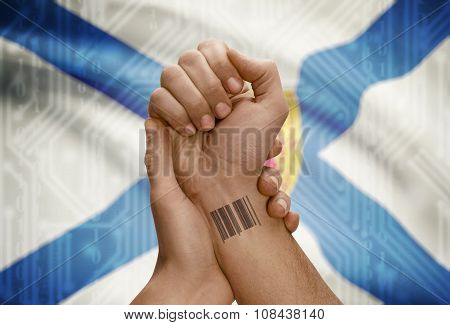 Barcode Id Number On Wrist Of Dark Skin Person And Canadian Province Flag On Background - Nova Scoti