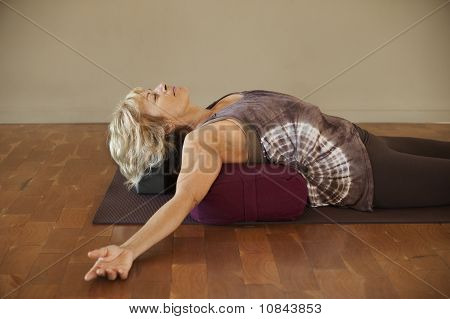 Woman On Yoga Bolster