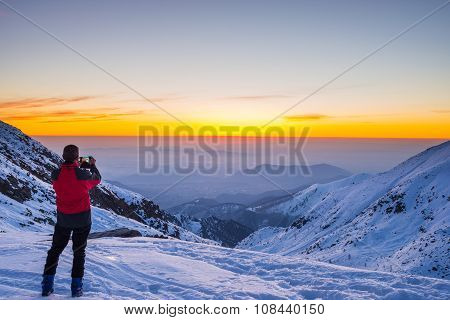 Alpinist Taking Selfie At Twilight On Mountain Summit