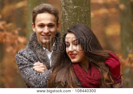 young couple in the park, autumn concept
