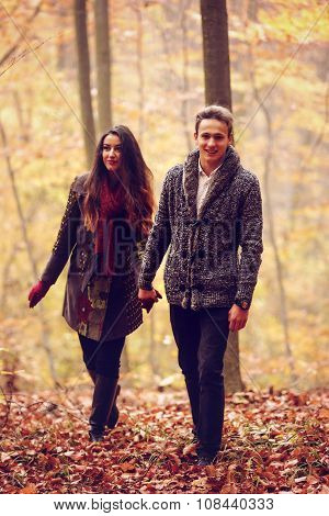 Lovers Walking Hand In Hand In Autumn Park