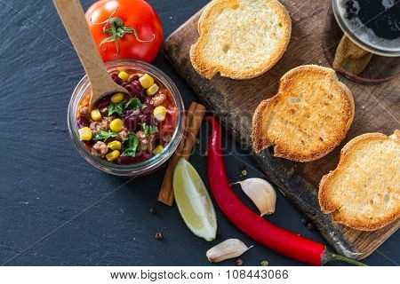 Chili con carne served on toast