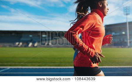 African Female Athlete Training On Race Track