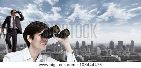 Business woman with binoculars over urban banner background.