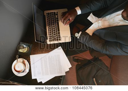 Businessman At Coffee Shop Working On Laptop