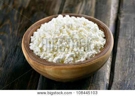 Curd In Bowl On Wooden Table
