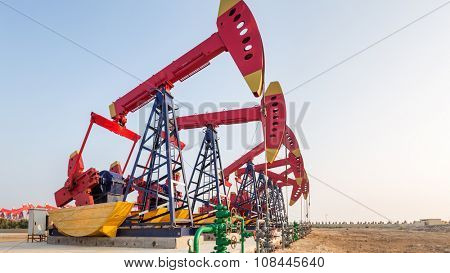landscape of oil field with pump units in blue sky