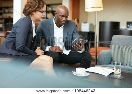 Business People Meeting In A Coffee Shop