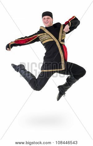 young man wearing a folk costume jumping against isolated white with copyspace
