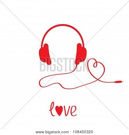 Red Headphones And Cord In Shape Of Heart.  White Background.