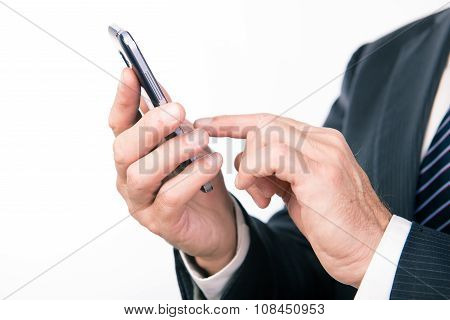 Businessman's Hands Writing Message On Smartphone