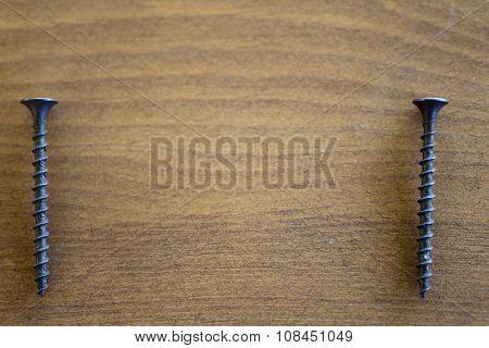 Screws On A Table
