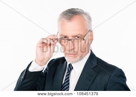 Confident Intelligent  Old Man In Business Suit  Holding Glasses
