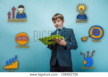 Teen boy businessman enthusiastically working on the tablet coll