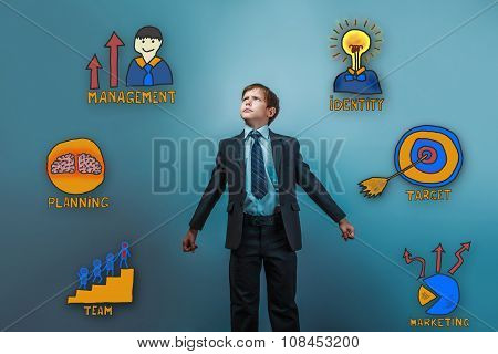 Teen boy businessman is looking up opened his arms a serious col