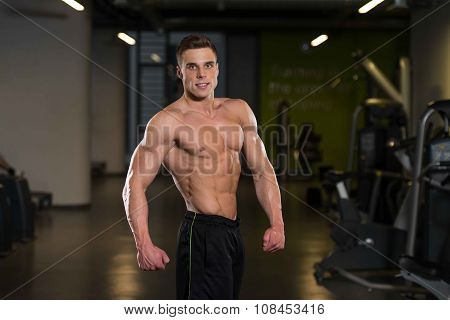 Man In Gym Showing His Well Trained Body