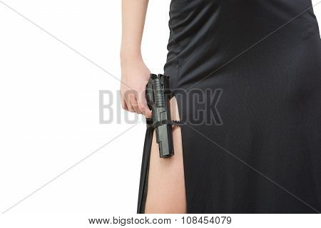 beautiful girl in evening dress holding gun. Isolated on white background