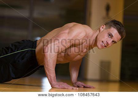 Young Man Exercising Push Ups